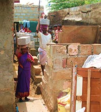 Gokulappa and his wife building their new home